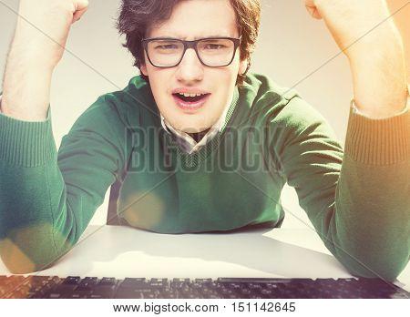 Furious Gesticulating Man In Glasses