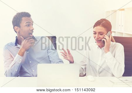 Young Woman Calling Somebody While Man Watches Her, Toned