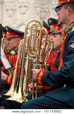 MOSCOW, RUSSIA - June 4, 2016: Military brass band trombonists are holding their trombones covered with raindrops. Festival of military orchestras