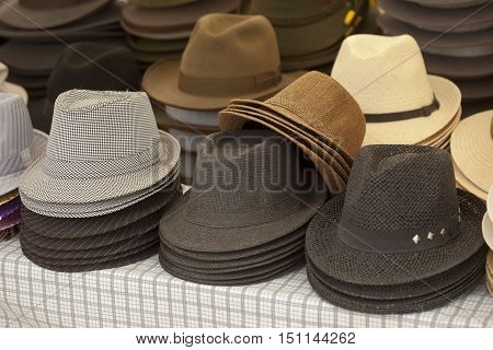 Various old style hats in assortment pile
