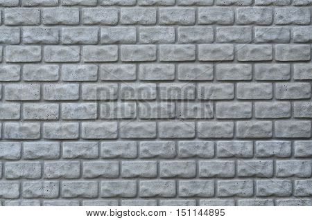 Weathered stained old brick wall background pattern
