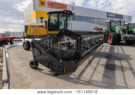 Tyumen, Russia - April 04. 2014: IV Tyumen specialized exhibition Agricultural Machinery and Equipment. Harvester demonstration. Side view