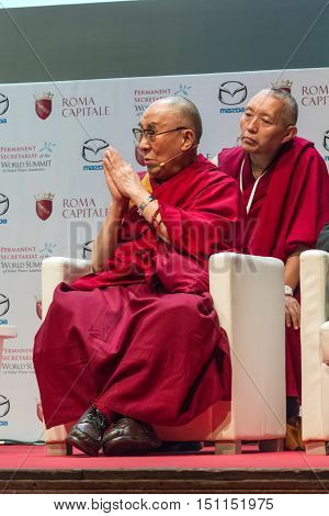 Rome Italy - December 13 2014: World Summit of Nobel Peace Laureates 2014. The Dalai Lama during his speech to the conference at the autidoriom Parco della Musica in Rome