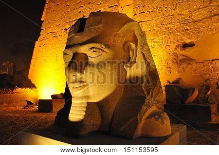 Close-up of Egyptian illuminated statue of pharaoh at night