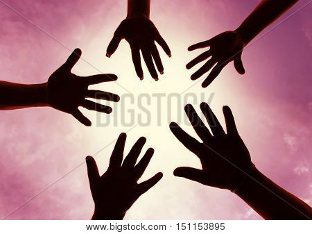 Five hands symbol of union touch white light