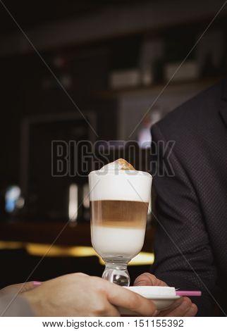 coffee latte macchiato with the foam in a glass