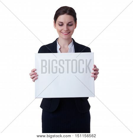 Smiling businesswoman standing over white isolated background with white blank board, business, education, office, advertising concept