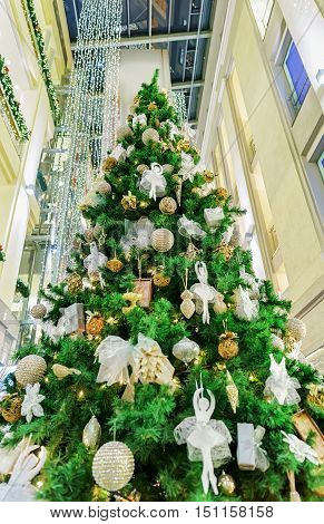Traditional Christmas Tree At Galerija Centrs In Old Riga