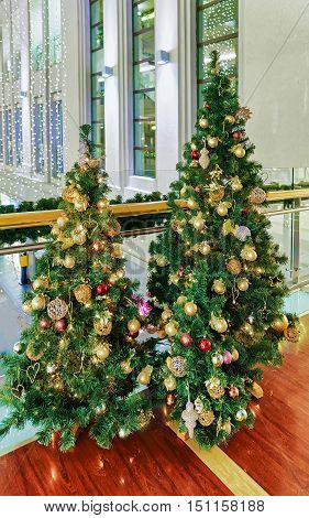 Two Christmas Trees Displayed At The Galerija Centrs In Riga