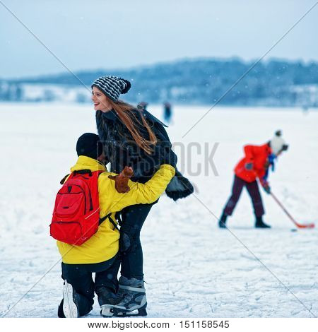 Young Girl And Fellow At Winter Rink In Trakai