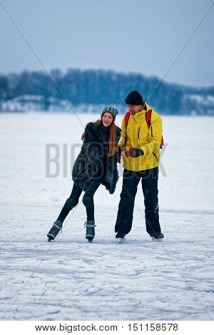 Young Girl And Fellow Ice Skating In Trakai Lithuania