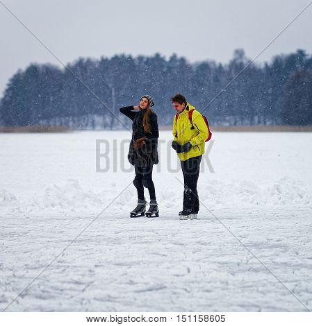 Young Girl And Fellow Ice Skating In Trakai