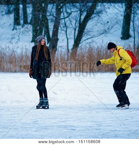 Young Girl And Fellow Ice Skating In Winter Trakai