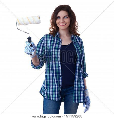 Smiling young woman in casual clothes over white isolated background paint roller, happy people and construction concept