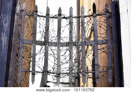 Iron Grate With Barbed Wire
