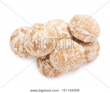 Pile of round gingerbread  small cakes with sugar powder isolated over the white background