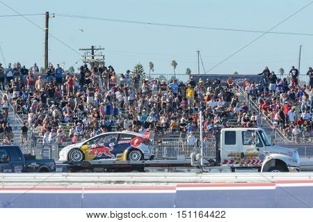 San Pedro USA - October 8 2016: Tow truck towing Oliver Eriksson car during the Red Bull Global Rallycross Championship Port of Los Angeles.