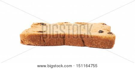 Single rusks with the pieces of dried fruits isolated over the white background