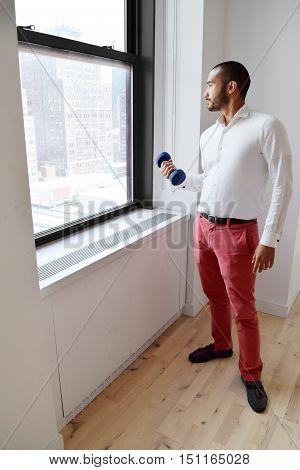Hispanic Businessman Working Out