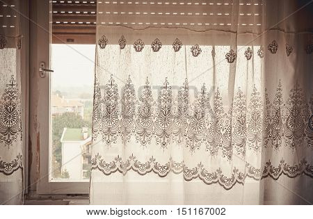 Part of an old curtain details of an embroidery decoration window in the back day time.