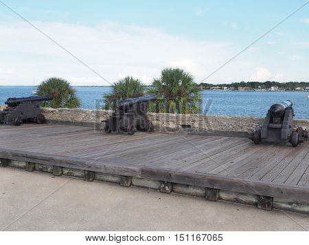 cannons at Castillo de San Marcos fort in St. Augustine Florida. The fort is the oldest masonry fort in the United States. It is located near Matanzas Bay. THe fort is constructed of coquina.