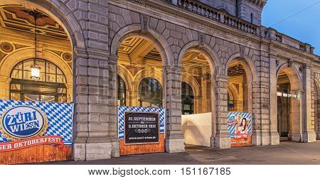 Zurich, Switzerland - 9 October, 2016: facade of Zurich main railway station building with Oktoberfest banners in early morning, view from Bahnhofquai quay. Zurich main railway station is the largest railway station in Switzerland.