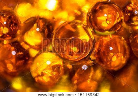 Bright orange translucent gel ball close up