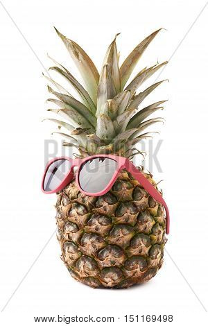 Whole raw fresh pineapple with sunglasses isolated over white background