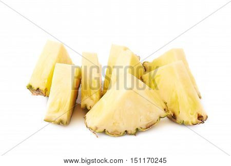 Pile of raw fresh pineapple sliced isolated over white background