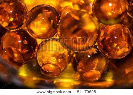 Bright orange translucent gel ball close up
