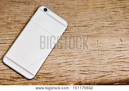 smart phone on the old wooden table
