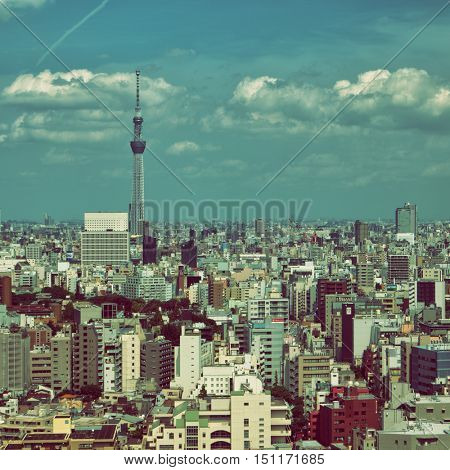 Tokyo - June 2016: Aerial view of city with Skytree and clouds on blue sky.