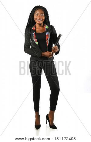 Portrait of beautiful African American businesswoman standing isolated over white background