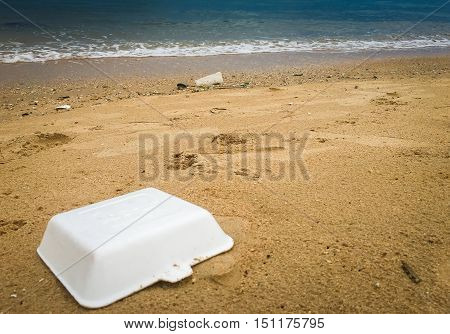 Styrofoam on beach, pollution, waste on beach, garbage on shore.