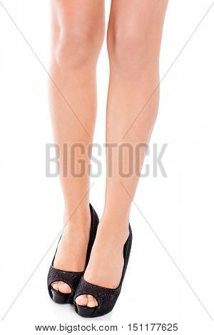 Slim female legs wearing black high heels