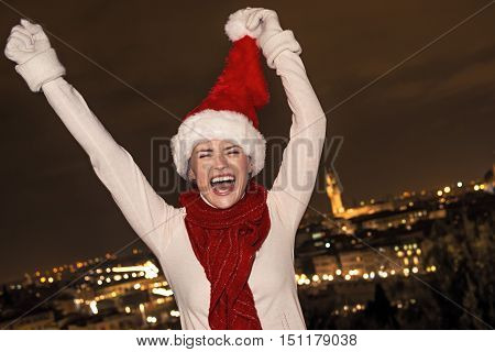 Cheerful Woman In Christmas Hat Rejoicing In Florence, Italy