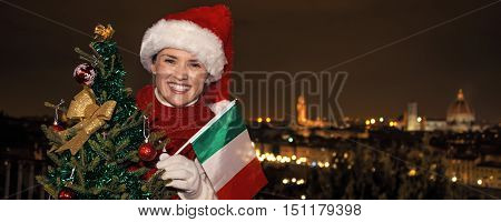 Happy Woman In Florence With Christmas Tree And Italian Flag