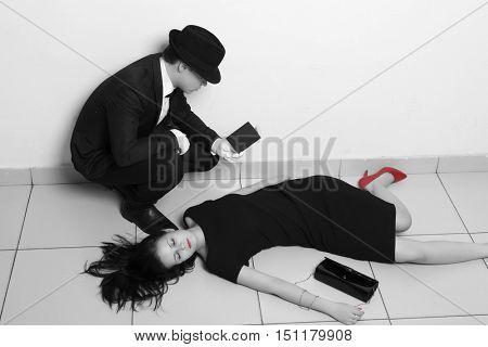 Detective investigating the crime scene