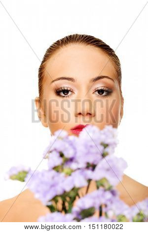 Sensual young spa woman holding flower.
