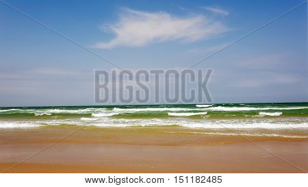 Ocean waves roll in from the Gulf of Mexico at Isla Blanca Park on South Padre Island in Texas