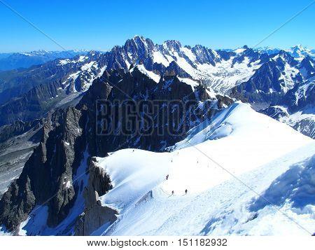 Alpinists on Aiguille du Midi, Mont-Blanc massif, Chamonix, Alps, France