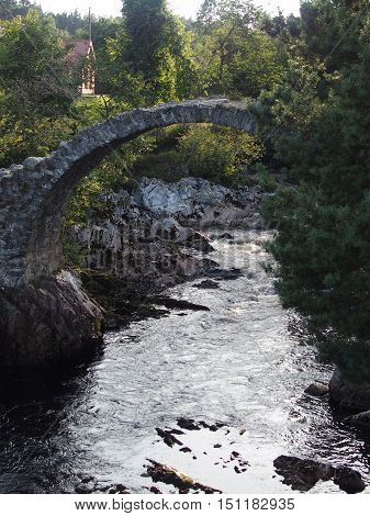 The old stone bridge in Carrbridge, Scotland