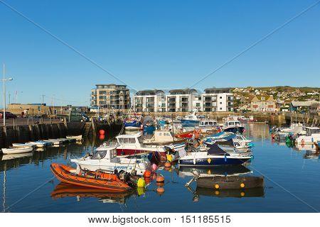 WEST BAY, DORSET, UK-SEPTEMBER 22nd 2016:  Fine calm late summer weather was enjoyed by visitors to West Bay harbour, Dorset, England, UK on Thursday 22nd September 2016