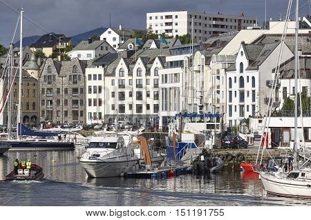 Alesund. Buidings and canal. Norwegian traditional tourist destination. Horizontal