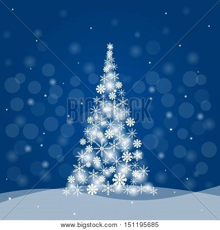 Christmas tree made of snowflakes on blue background