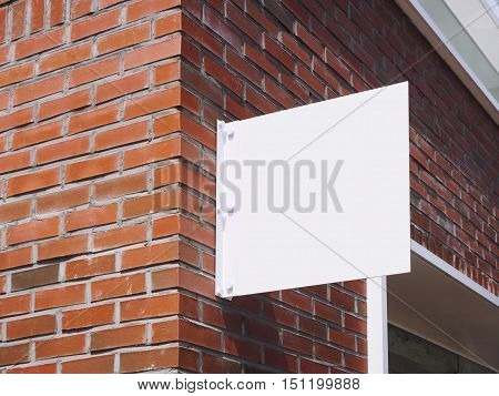 Signboard shop Mock up White metal sign display on brick wall Building exterior