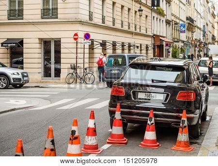 PARIS FRANCE - MAY 21 2016: Rear view of Bentley Bentayga Hybrid SUV on the streets of Paris France- street fastion