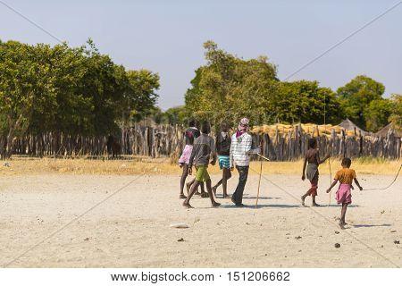Caprivi, Namibia - August 20, 2016: Poor Teenagers Walking On The Roadside In The Rural Caprivi Stri