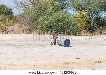 Caprivi, Namibia - August 20, 2016: Poor Teenager Playing On The Roadside In The Rural Caprivi Strip