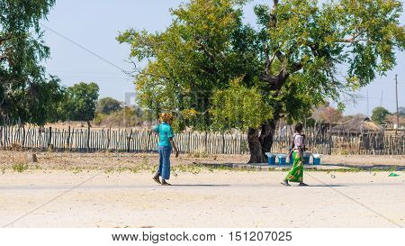 Caprivi, Namibia - August 20, 2016: Poor Women Walking On The Roadside In The Rural Caprivi Strip, T